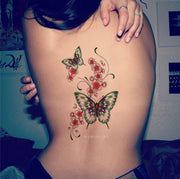 Cute Pink Watercolor Floral Flower Butterfly Back Spine Temporary Tattoo Ideas for Women -  Ideas de tatuajes de flores de mariposa para mujeres - www.MyBodiArt.com