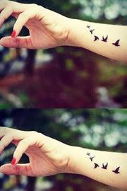 Cute Small Flying Bird Sparrow Silhouette Wrist Arm Tattoo Ideas for Women - tatuaje de la muñeca pequeña silueta de pájaro volador  - www.MyBodiArt.com