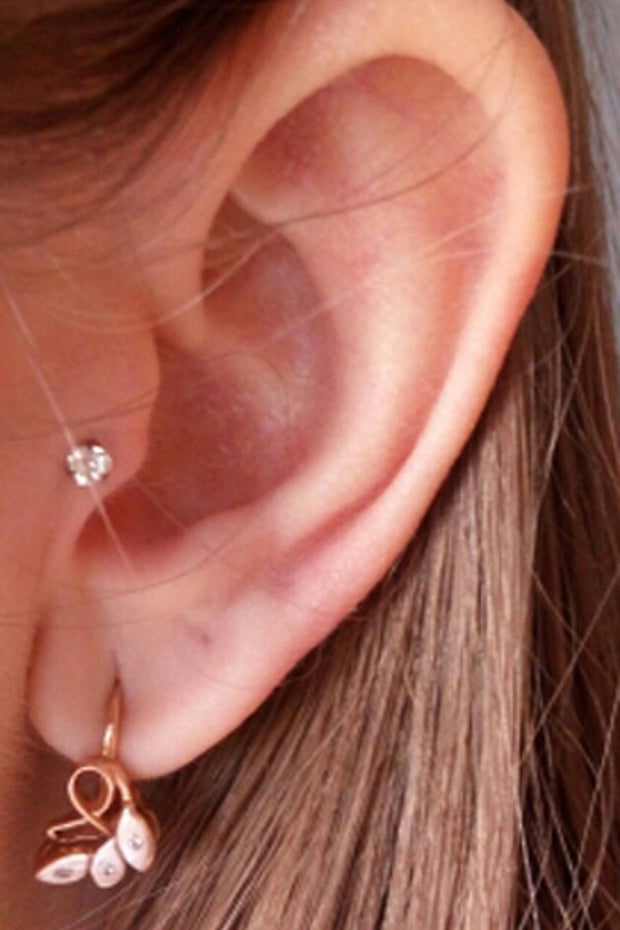 Minimal Ear Piercing Ideas for Teen Girls - Popular Tragus Piercing Jewelry Crystal Stud Earring - www.MyBodiArt.com