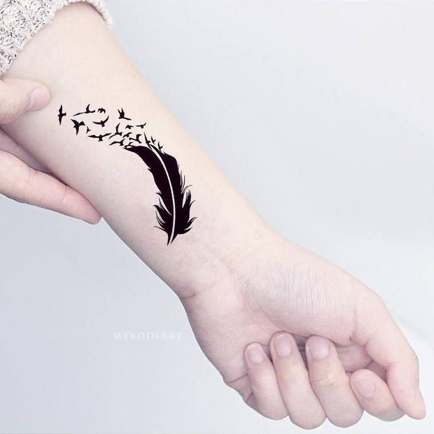 Cute Small Feather Sparrow Silhouette Wrist Tattoo Ideas for Women - www.MyBodiArt.com