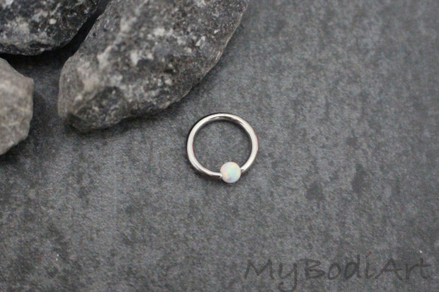 Opal Daith Ring Piercing at MyBodiArt