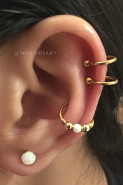 Classy Feminine Multiple Ear Piercing Ideas for Teenagers - Double Gold Cartilage Ring Conch Helix Rook Daith Hoop Opal Lobe Earring Stud - www.MyBodiArt.com