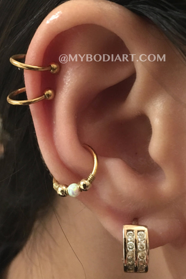 Double Cartilage Ear Piercing Ideas - Conch Earring Ring Hoop in Gold - Huggie Earring - www.MyBodiArt.com