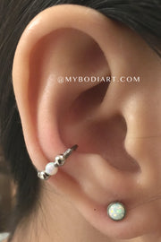 Classy Multiple Ear Piercing Ideas for Teens - Conch Cartilage Helix Rook Daith Opal Ring Hoop Earring - Lobe Stud - www.MyBodiArt.com