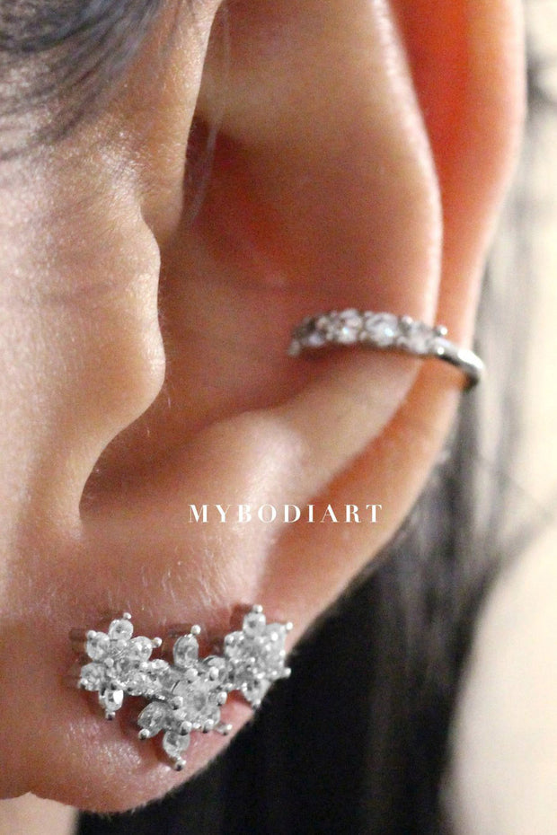 Cute Feminine Ear Piercing Ideas for Teens - Triple Crystal Flower Cartilage Conch Earring for Women - www.MyBodiArt.com #earrings