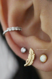 Cute Multiple Ear Piercing Jewelry Ideas - Leaf Feather Gold Small Dainty Gold Earring Stud for Cartilage, Helix, Tragus, Conch - www.MyBodiArt.com #earrings #earpiercings #cartilage