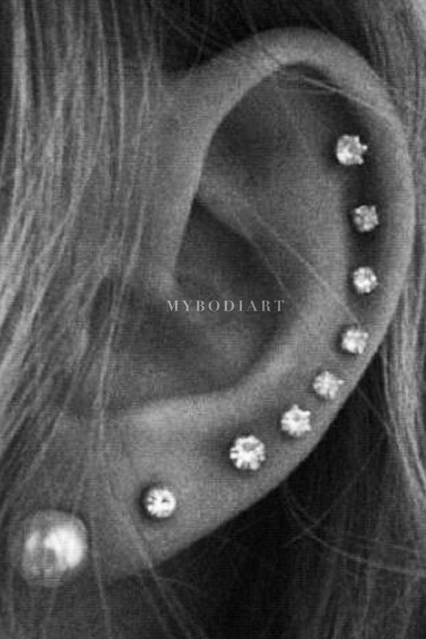All the Way Around Cartilage Helix Ear Piercing Ideas for Women -  lindo piercing de cartílago ideas - www.MyBodiArt.com
