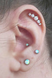 Multiple Cute Ear Piercing Ideas at MyBodiArt.com - 5 Opal Cartilage Pinna Earring - Opalite 16G Stud Barbell