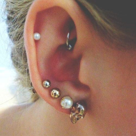 Pearl Helix Piercings at MyBodiArt