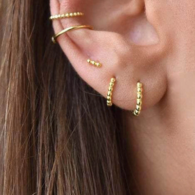 Pretty Minimalist Gold Hoop Huggie Earrings Ear Piercing Ideas for Women - www.MyBodiArt.com