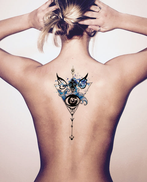 Watercolor Arrow Back Tattoo Ideas for Women - Black Henna Tribal Blue Angel Wings Evil Eye Tattoos at MyBodiArt.com