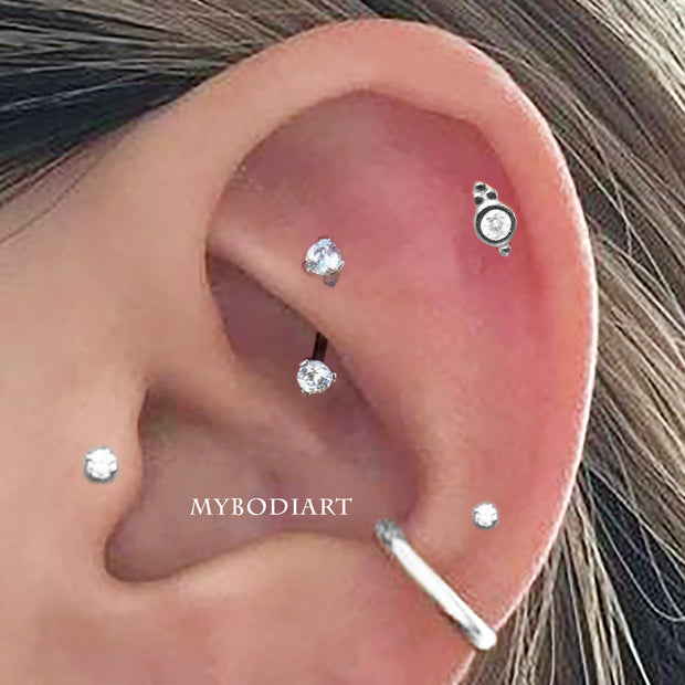 Cute Rook Ear Piercing Jewelry Ideas for Women Crystal Curved Barbell - www.MyBodiArt.com #earrings