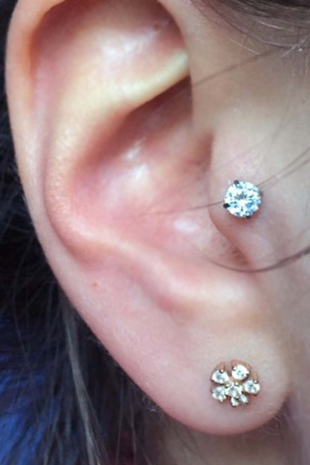 trendy minimal ear piercing ideas - crystal tragus earring stud - star lobe jewelry - ideas para perforar orejas - www.mybodiart.com