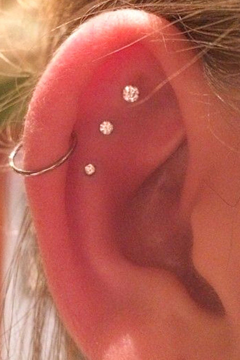 Cute Triple Cartilage Multiple Ear Piercing Ideas for Women -  lindo piercing de cartílago ideas - www.MyBodiArt.com