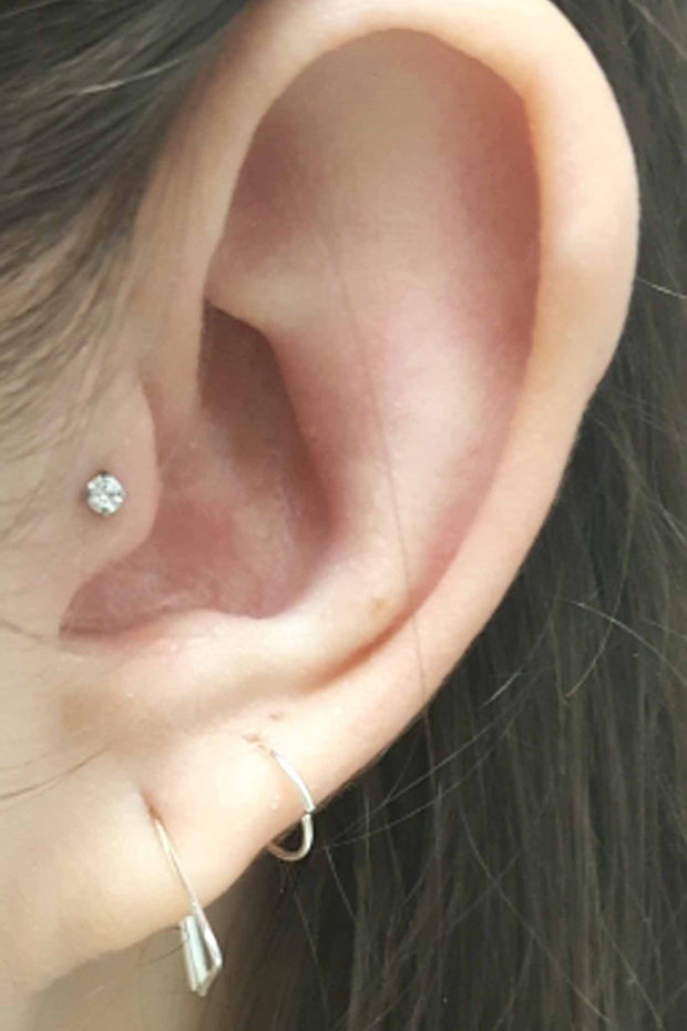 Minimalistic Multiple Ear Piercing Ideas at MyBodiArt.com - Crystal Tragus Stud Earring - Arrow Ring Hoop