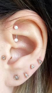Cute Opal Rook Multiple Ear Piercing Ideas for Women -  lindas ideas para perforar orejas para mujeres - www.MyBodIArt.com