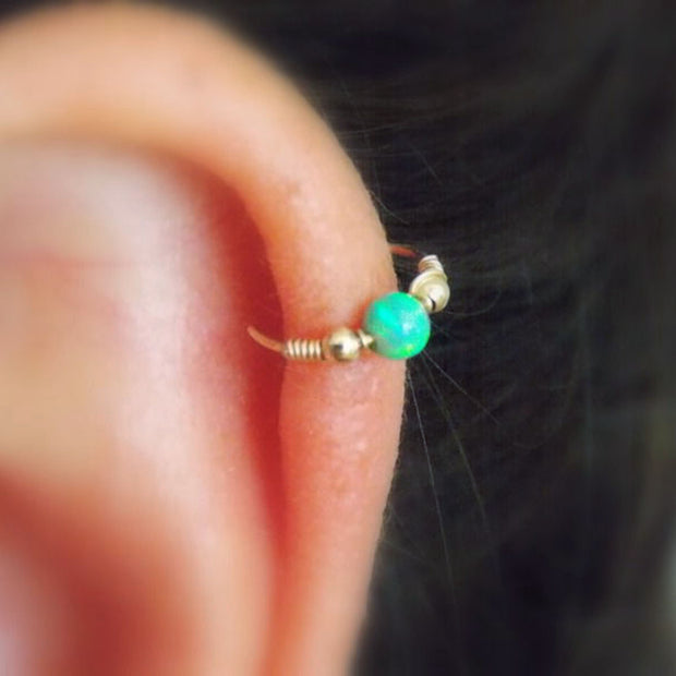 Green Opal Cartilage Ear Piercing Jewelry Ideas in Gold for Women  -  lindo opalo cartilago oreja perforacion joyas ideas - www.MyBodiArt.com