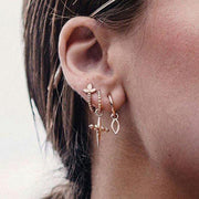 Cute Ear Piercing Ideas for Teenagers Teen Girls - Triple Cross Ear Lobe Earrings Cartilage - www.MyBodiArt.com