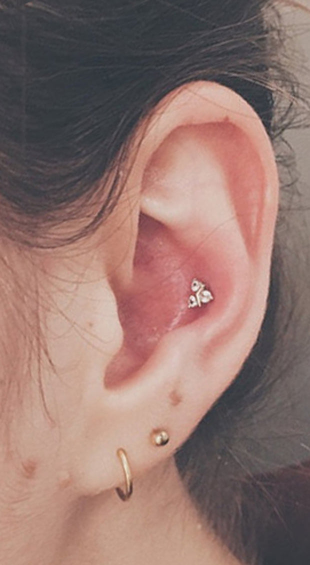 Popular Cute Ear Piercing Ideas for Teenagers - Conch Earring Stud Triple Ear Lobe - www.MyBodiArt.com