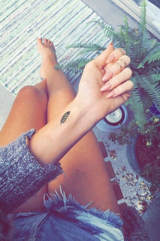 Small Indian Feather Wrist Black Henna Tattoo Ideas for Women at MyBodiArt.com