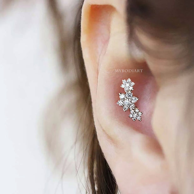 Cute Triple Flower Conch Ear Piercing Ideas for Women -  ideas simples de joyería piercing de oreja - www.MyBodiArt.com