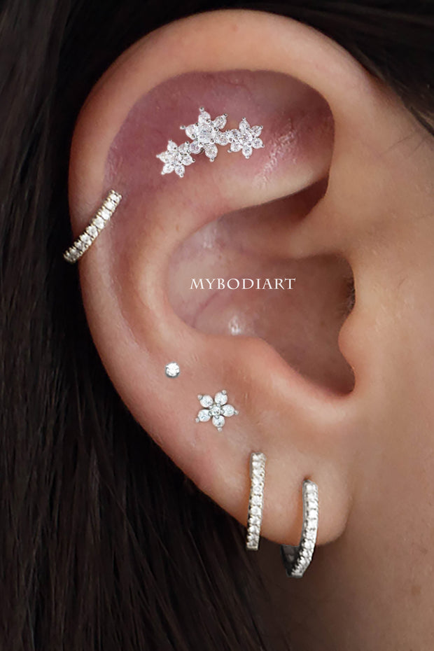 Multiple Ear Piercings - Ideas for Cartilage, Helix, Tragus, Conch Earrings - Triple Crystal Flower Stud 16G - www.MyBodiArt.com