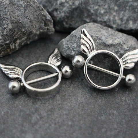Angel Wings and Circle Nipple Ring Piercing