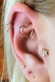 Cute Ear Piercing Ideas - Gold Heart Rook Piercing Jewelry 16G at MyBodiArt.com - Flower Tragus Stud Barbell - Cartilage Ring