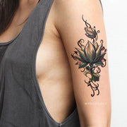 Lotus Arm Bicep Tattoo Ideas for Woman Tribal Boho Floral Flower Side Tat - tatuaje de costilla de loto - www.MyBodiArt.com