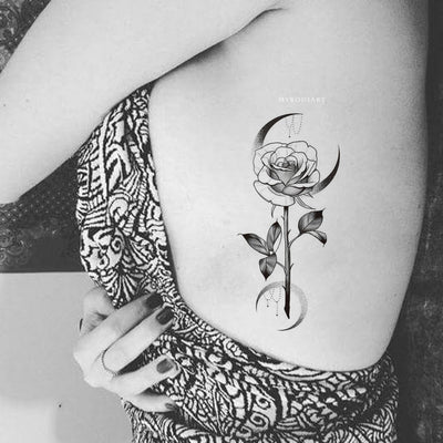 Beautiful Moon Crescent Rose Floral Flower Rib Tattoo Ideas for Women - www.MyBodiArt.com