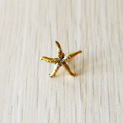 Simple 16G Oceana Starfish Gold Ear Piercing Barbell for Ear Piercing at MyBodiArt.com