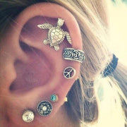 Cute Ear Piercing Ideas at MyBodiArt.com - Turtle Earring - Antiqued Silver Ear Cuff - Peace Stud at MyBodiArt.com