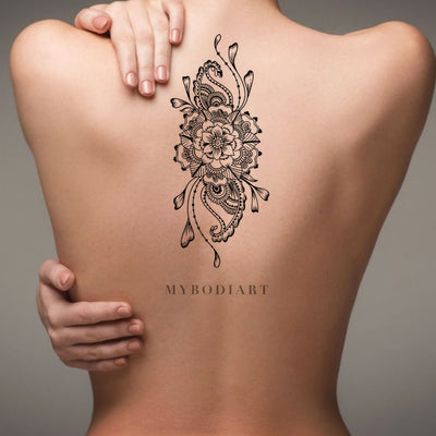 Boho Mandala Flower Back Tattoo Ideas for Women Black Floral Tribal Linework Spine Tat - ideas bohemias de la parte posterior del tatuaje de la flor - www.MyBodiArt.com #tattoos