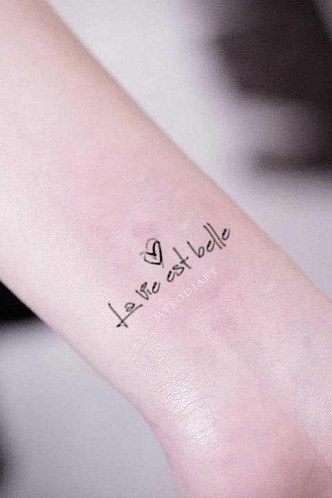 La Vie Est Belle Quote Script Wrist Tattoo Ideas for Women - www.MyBodiArt.com #tattoos