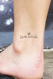 La Vie Est Belle Quote Script Ankle Tattoo Ideas for Women - www.MyBodiArt.com #tattoos