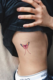 Cute Watercolor Butterfly Rib Tattoo Ideas for Women - ideas de tatuajes de costillas de mariposa - www.MyBodiArt.com #tattoos
