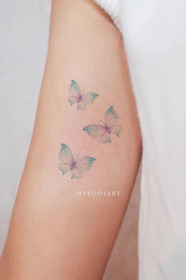 Delicate Watercolor Butterfly Arm Bicep Tattoo Ideas for Women - ideas del tatuaje del brazo de mariposa - www.MyBodiArt.com #tattoos