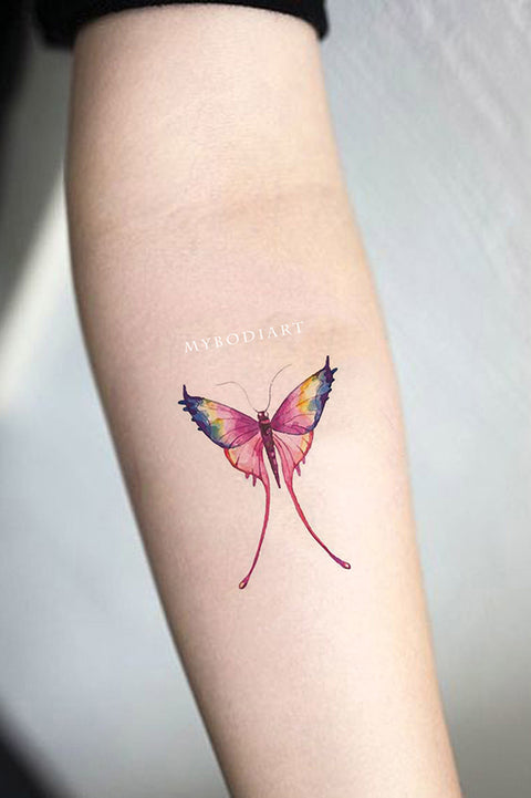 Trending Cute Rainbow Small Watercolor Butterfly Wrist Tattoo Ideas for Females - www.MyBodiArt.com #tattoos