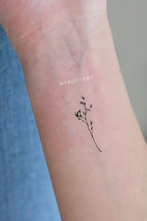 dainty floral flower branch leaf wrist tattoo ideas for females - www.mybodiart.com