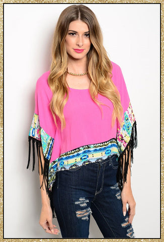 Fuchsia boho style top with multi-colored trim and fringe