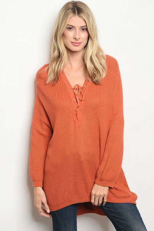 Burnt orange long sleeve knit sweater with lace up front