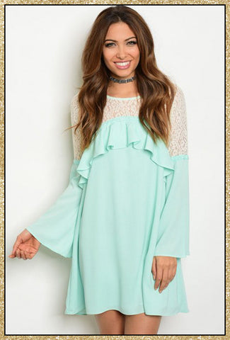 Mint long flared sleeved dress with cream lace-like design on the upper chest and arms