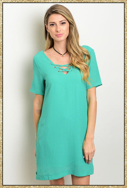Kelly green short sleeve dress with small criss-cross design on upper chest