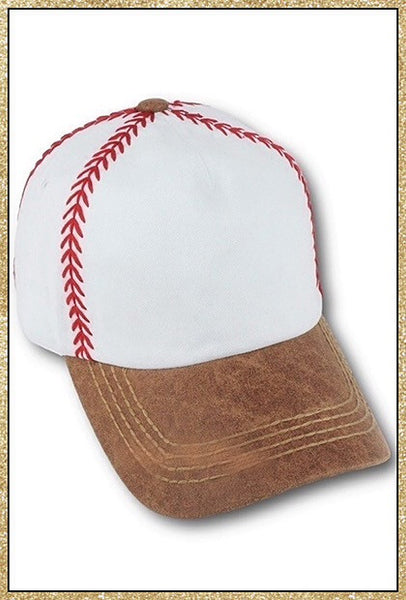 White hat with red stitching to resemble a baseball and a camel colored brim to resemble a baseball glove
