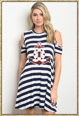 Navy and white striped cold shoulder dress with a red and white sequin anchor design on the front.