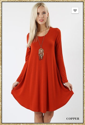 Copper long sleeve tunic dress with side pockets.