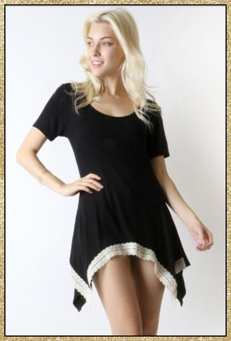 Short sleeve black top with crochet detailing along the asymmetrical bottom trim.