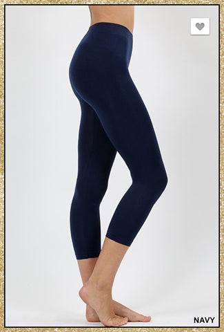 Navy blue seamless capri leggings.