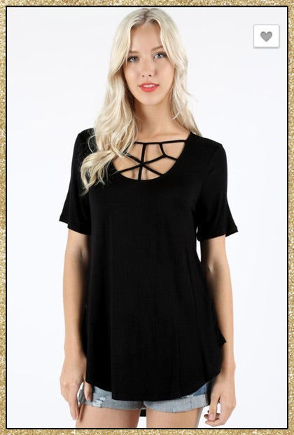 Short sleeve black top with web like detail on chest.