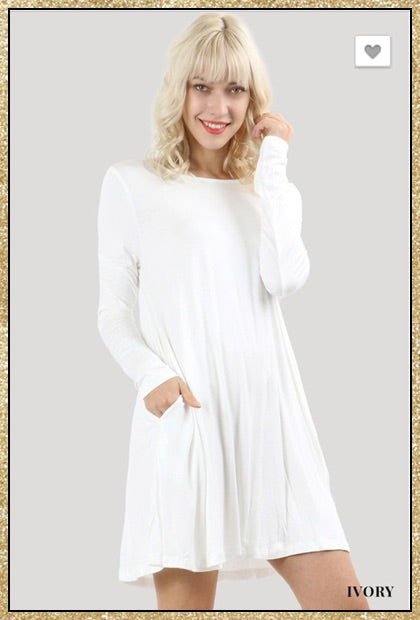 Ivory long sleeve tunic dress with side pockets.